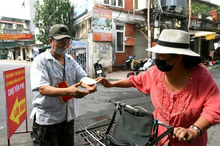 Every Hanoi resident needs a shopping ticket to access markets in the capital