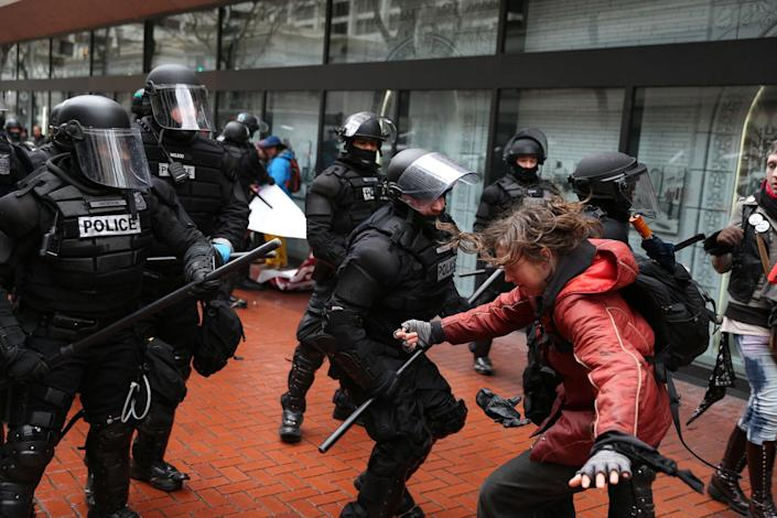 <p>Protesters clash with police Monday, Feb. 20, 2017, in Portland, Ore. Thousands of demonstrators turned out Monday across the U.S. to challenge President Donald Trump in a Presidents Day protest dubbed Not My President's Day. (Dave Killen/The Oregonian via AP) </p>