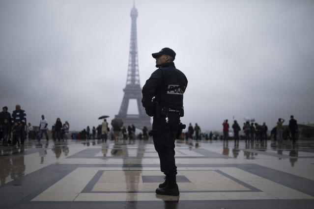 <p>A French police officer patrols at Trocadero plaza with the Eiffel Tower in the background in Paris, France, May 6, 2017. Voting for France's next president starts in overseas territories and French embassies abroad, as a blackout on campaigning descends so that voters can reflect on whether to entrust their country's future to independent Emmanuel Macron or far-right populist Marine Le Pen. (Photo: Kamil Zihnioglu/AP) </p>