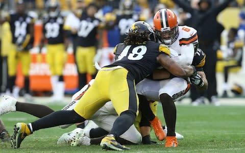 <span>Baker Mayfield is sacked by Bud Dupree</span> <span>Credit: USA Today </span>