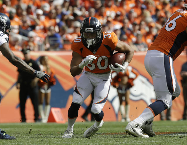 "FILE - In this Sept. 9, 2018, file photo, Denver Broncos running back Phillip Lindsay runs upfield during the first half of an NFL football game against the Seattle Seahawks, in Denver. Lindsay is taking the NFL by storm. He's also taking it all in stride. ""I am just playing football, that's it,"" the Denver Broncos' running back said after becoming the first undrafted player in NFL history to eclipse 100 yards from scrimmage in each of his first two NFL games. (AP Photo/Jack Dempsey, File)"