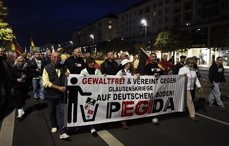 Supporters of PEGIDA attend a protest rally on October 5, 2015 in Dresden, eastern Germany (AFP Photo/Tobias Schwarz)