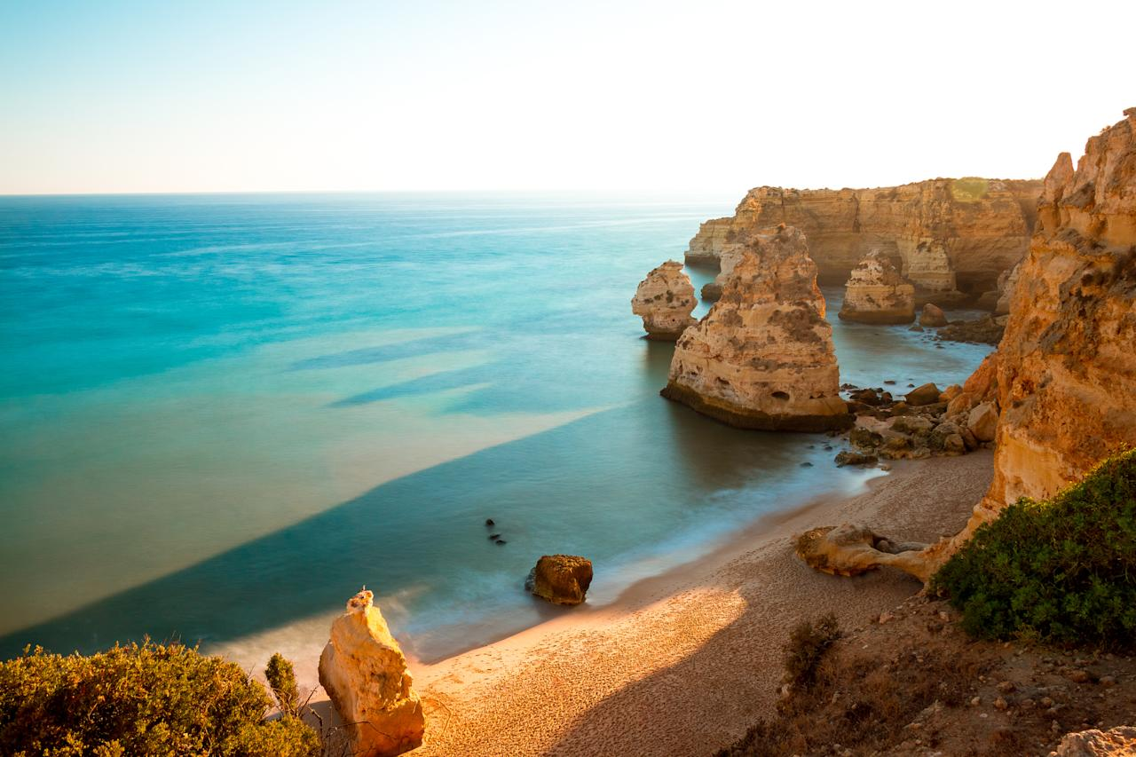 "While southern Portugal is more commonly frequented by British tourists, the Algarve boasts great beauty too – including the breathtaking beaches in the protected Ria Formosa National Park. <a href=""https://www.i-escape.com/conversas-de-alpendre""><strong>Conversas del Alpendre</strong></a><strong> </strong>is a small hotel just 2km from Fábrica beach for £85, while there's also the <a href=""https://www.i-escape.com/tavira-boutique-apartments""><strong>Tavira Boutique Apartments</strong></a><strong> </strong>located in a converted convent in Tavira's old town is close to Ria Formosa's best beaches (£146). [<em>Photo: Getty]</em>"