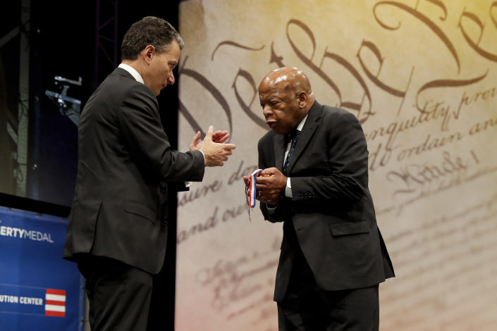Rep. John Lewis, right, D-Ga., reacts after being presented with the Liberty Medal for his dedication to civil rights from National Constitution Center CEO Jeffrey Rosen during a ceremony on Sept. 19, 2016, in Philadelphia. The honor is given annually to an individual who displays courage and conviction while striving to secure liberty for people worldwide. (Photo: Matt Slocum/AP)