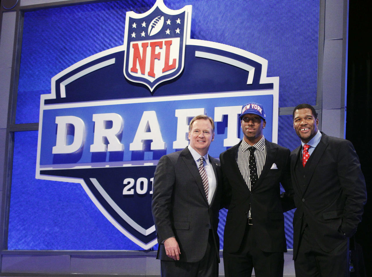 Louisiana State wide receiver Rueben Randle poses for photographs with NFL Commissioner Roger Goodell, left, and Michael Strahan, right, after being selected 63rd overall by the New York Giants in the second round of the NFL football draft at Radio City Music Hall, Friday, April 27, 2012, in New York. (AP Photo/Frank Franklin II)