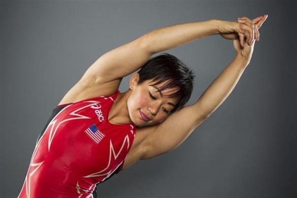 Freestyle wrestler Clarissa Chun stretches while posing for a portrait during the 2012 U.S. Olympic Team Media Summit in Dallas, May 15, 2012.