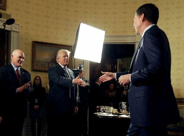 PHOTO: President Donald Trump greets Director of the FBI James Comey as Director of the Secret Service Joseph Clancy watches during the Inaugural Law Enforcement Officers and First Responders Reception at the White House in Washington, Jan. 22, 2017. (Joshua Roberts/Reuters, FILE)