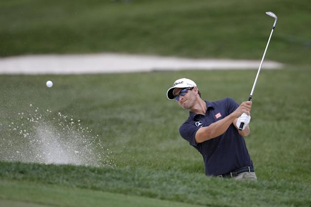 Adam Scott, of Australia, hits out of a bunker onto the 18th green during the first round of the Honda Classic golf tournament on Thursday, Feb. 27, 2014, in Palm Beach Gardens, Fla. (AP Photo/Lynne Sladky)