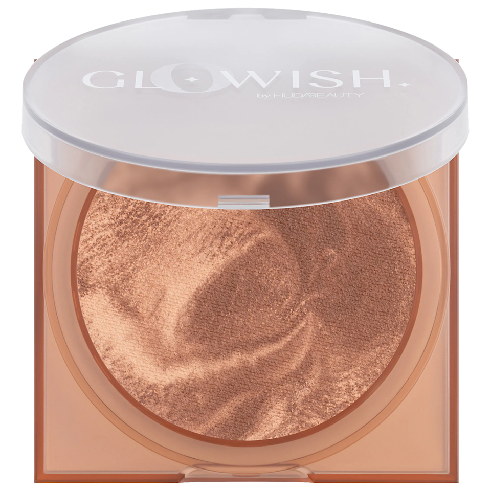 """This silky bronzer has a mix of shimmering and matte powders, so your left with an airbrushed, luminous finish that blurs pores and imperfections. One swipe gives you a natural look, but it can be built up for more warmth if that's your style. $31, Sephora. <a href=""""https://shop-links.co/1743415885327758368"""" rel=""""nofollow noopener"""" target=""""_blank"""" data-ylk=""""slk:Get it now!"""" class=""""link rapid-noclick-resp"""">Get it now!</a>"""