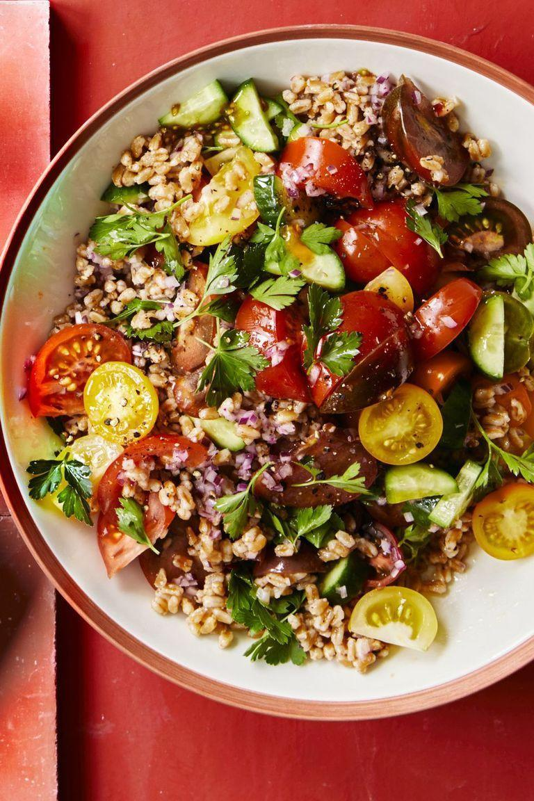 """<p>Farro might be a lesser used grain, but it makes for a delicious salad component. This recipe combines it with tons of fresh veggies for a meal that will leave you feeling energized.</p><p><em><a href=""""https://www.womansday.com/food-recipes/food-drinks/a22075346/tomato-and-cucumber-farro-salad-recipe/"""" rel=""""nofollow noopener"""" target=""""_blank"""" data-ylk=""""slk:Get the Tomato and Cucumber Farro Salad recipe."""" class=""""link rapid-noclick-resp"""">Get the Tomato and Cucumber Farro Salad recipe.</a></em></p>"""
