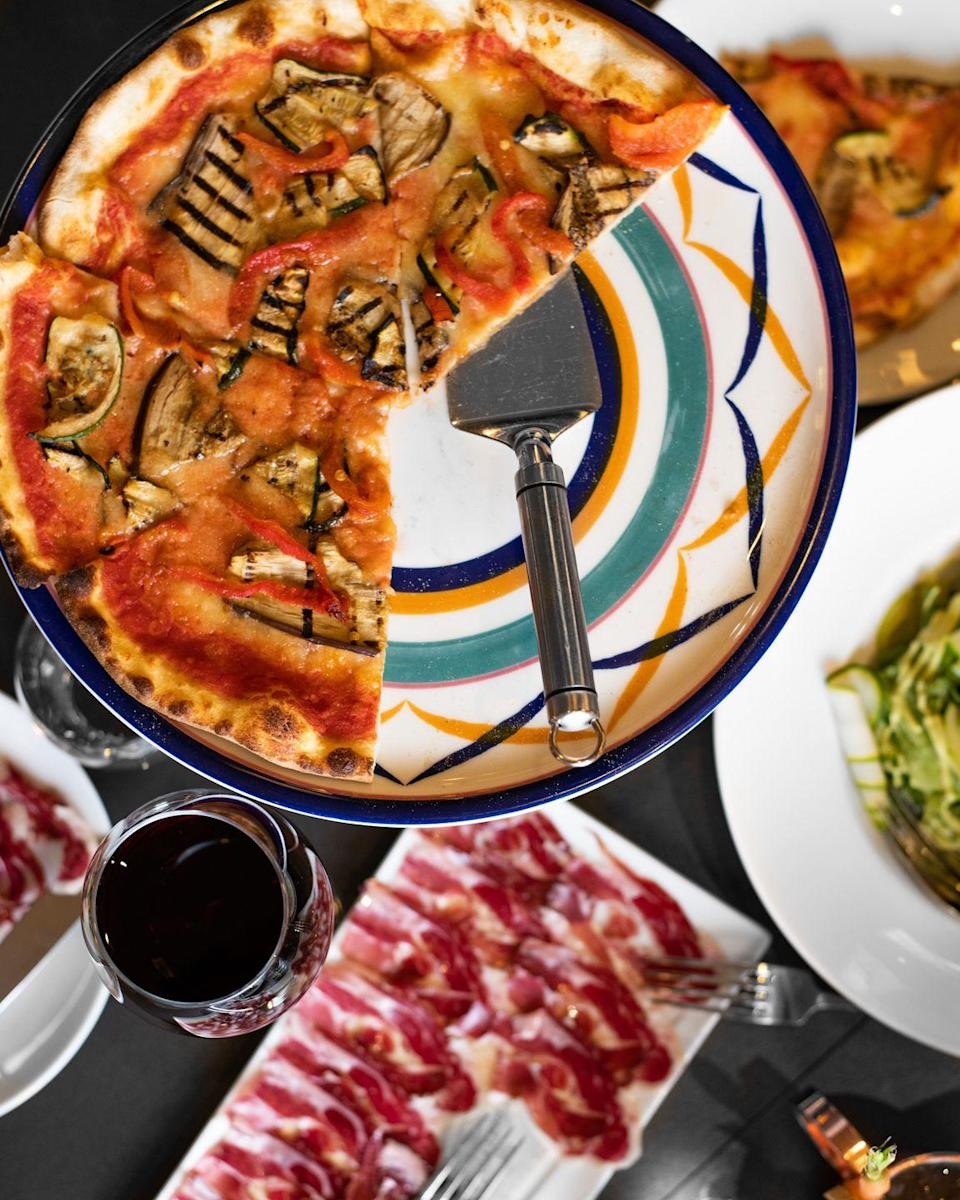 """<p>In locations across the world and in Knightsbridge and Marylebone in London, this pizzeria was founded in Porto Cervo, Sardinia in the Nineties and it's never gone out of style since.</p><p>The restaurants menu invites diners to choose from a variety of traditional and 'crazy' toppings, such as Pata Negra, shaved truffles and zucchini flowers. Oh, and did we mention there's lava cake and tiramisu on the menu?</p><p>Address: 32-34 Hans Cres, London SW1X 0LZ and 7 Paddington St, London W1U 5QH</p><p><strong>Click <a href=""""https://crazypizza.com/"""" rel=""""nofollow noopener"""" target=""""_blank"""" data-ylk=""""slk:here"""" class=""""link rapid-noclick-resp"""">here</a> for more information.</strong></p>"""