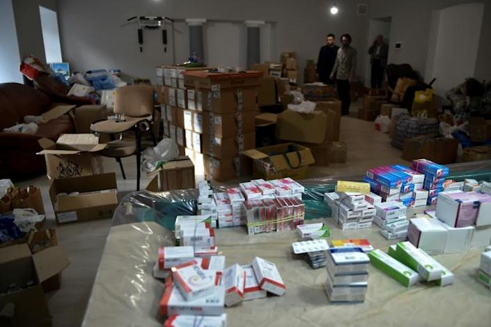 Donated medicines are packed into boxes at the Armenian embassy in Moscow in order to be sent as aid to Armenia