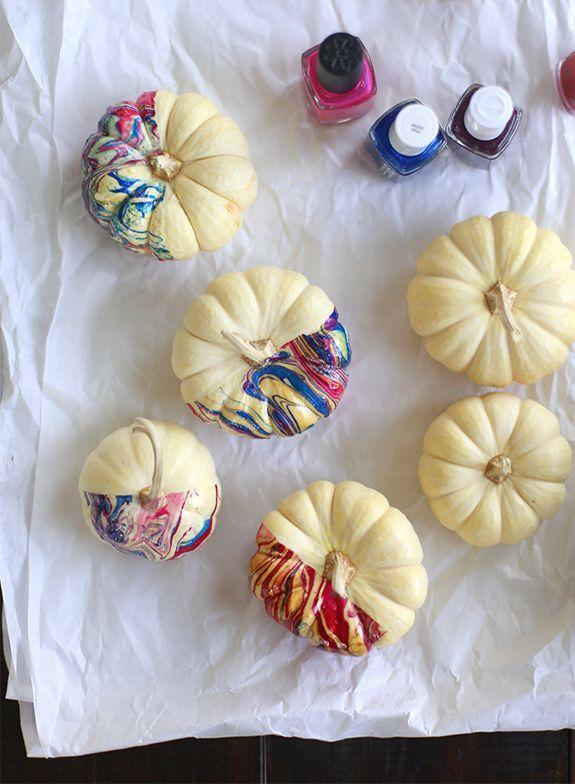 """<p>You can never have too much nail polish ... well, on second thought, you probably have enough to spare to dress up a handful of mini pumpkins. </p><p><em><a href=""""http://sayyes.com/2013/10/diy-marbled-pumpkins.html"""" rel=""""nofollow noopener"""" target=""""_blank"""" data-ylk=""""slk:Get the tutorial at Say Yes »"""" class=""""link rapid-noclick-resp"""">Get the tutorial at Say Yes »</a></em></p>"""