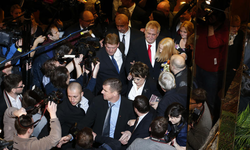 Presidential candidate Milos Zeman arrives with his daughter Katerina to address media after announcement of the preliminary results of the presidential elections in Prague, Czech Republic, Saturday, Jan. 26, 2013. According to the preliminary results he won the election with about 54.8 percent. (AP Photo/Petr David Josek)