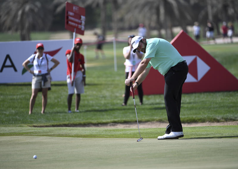 Shane Lowry of Ireland follows the ball after putting on the 9th green in round one of the Abu Dhabi Championship golf tournament, in Abu Dhabi, United Arab Emirates, Wednesday, Jan. 16, 2019. (AP/Martin Dokoupil)