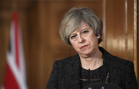 Britain's Prime Minister Theresa May holds a press conference with her counterpart from Italy  Paolo Gentiloni at Number 10 Downing Street in London