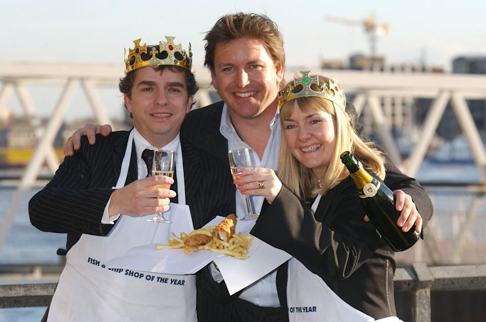 Celebrity chef James Martin (centre) with Greg and Caroline Howard, the owners of 'Our Plaice' in West Hagley in the Midlands, which has won the National Fish & Chip Shop of the Year Award.
