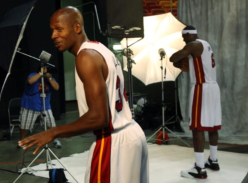 Miami Heat basketball player Ray Allen, left, makes fun of LeBron James, right, during the team's NBA media day in Miami, Friday, Sept. 28, 2012.  (AP Photo/Wilfredo Lee)