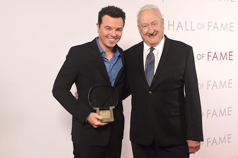 """Actor-writer-animator Seth MacFarlane, left, poses Tuesday with director Don Mischer and his Television Academy Hall of Fame statuette, which the """"Family Guy"""" creator said he planned to use to tip the valet after Tuesday's Television Academy Hall of Fame ceremony in Los Angeles."""