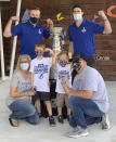 Malissa, front left, and Jesse Black, front right, with 5-year-old son Jase and 7-year-old son Mason, pose with the Stanley Cup and Tampa Bay Lightning players Steven Stamkos, top left, and Ryan McDonagh, top right, at the Children's Cancer Center in Tampa, Fla., on Oct. 16, 2020. The Lightning took the Stanley Cup to the Children's Cancer Center as part of their local tour of stops after winning the National Hockey League's championship trophy Sept. 28 in Edmonton, Alberta. (Kristina Hjertkvist/Tampa Bay Lightning via AP)