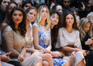 LONDON, ENGLAND - FEBRUARY 21: Vanessa White, Rochelle Humes, Millie Mackintosh, Whitney Port, Ella Eyre and Michelle Keegan attend the Julien Macdonald show during London Fashion Week Fall/Winter 2015/16 on February 21, 2015 in London, United Kingdom. (Photo by Mike Marsland/WireImage,)