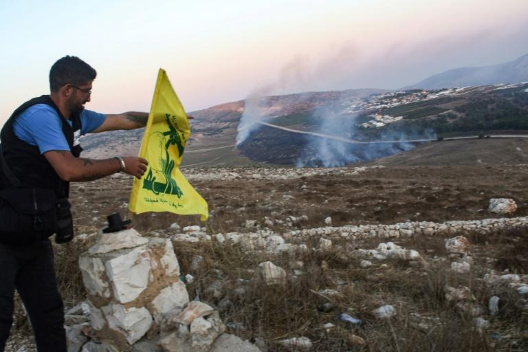 A previous flare-up between Hezbollah and Israel saw artillery and tank fire setting fields alight in southern Lebanon (AFP Photo/Mahmoud ZAYYAT)