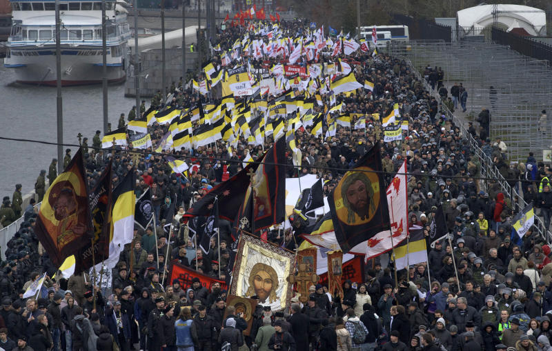 "Ultra nationalist demonstrators and activists march carrying the Russian Empire's black-yellow-white flags to mark National Unity Day, on the outskirts of Moscow, Sunday, Nov. 4, 2012. Chanting ""Russia for Russians"" and ""Migrants today, occupiers tomorrow,"" about 6,000 people, mostly young men, marched through a working-class neighborhood on the outskirts of the capital, while police stood shoulder to shoulder along the street, which was blocked to traffic. (AP Photo/Ivan Sekretarev)"