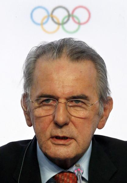 FILE - In this May 31, 2013, file photo, President of the International Olympic Committee (IOC) Jacques Rogge speaks during a news conference after an IOC executive board meeting at the SportAccord International Convention in St. Petersburg, Russia. Rogge's departure in September after 12 years as president has created the opportunity for power plays around the Olympic world. Organizations and individuals are staking out positions and forging alliances, each trying to secure a place in the shifting landscape. (AP Photo/Dmitry Lovetsky, File)