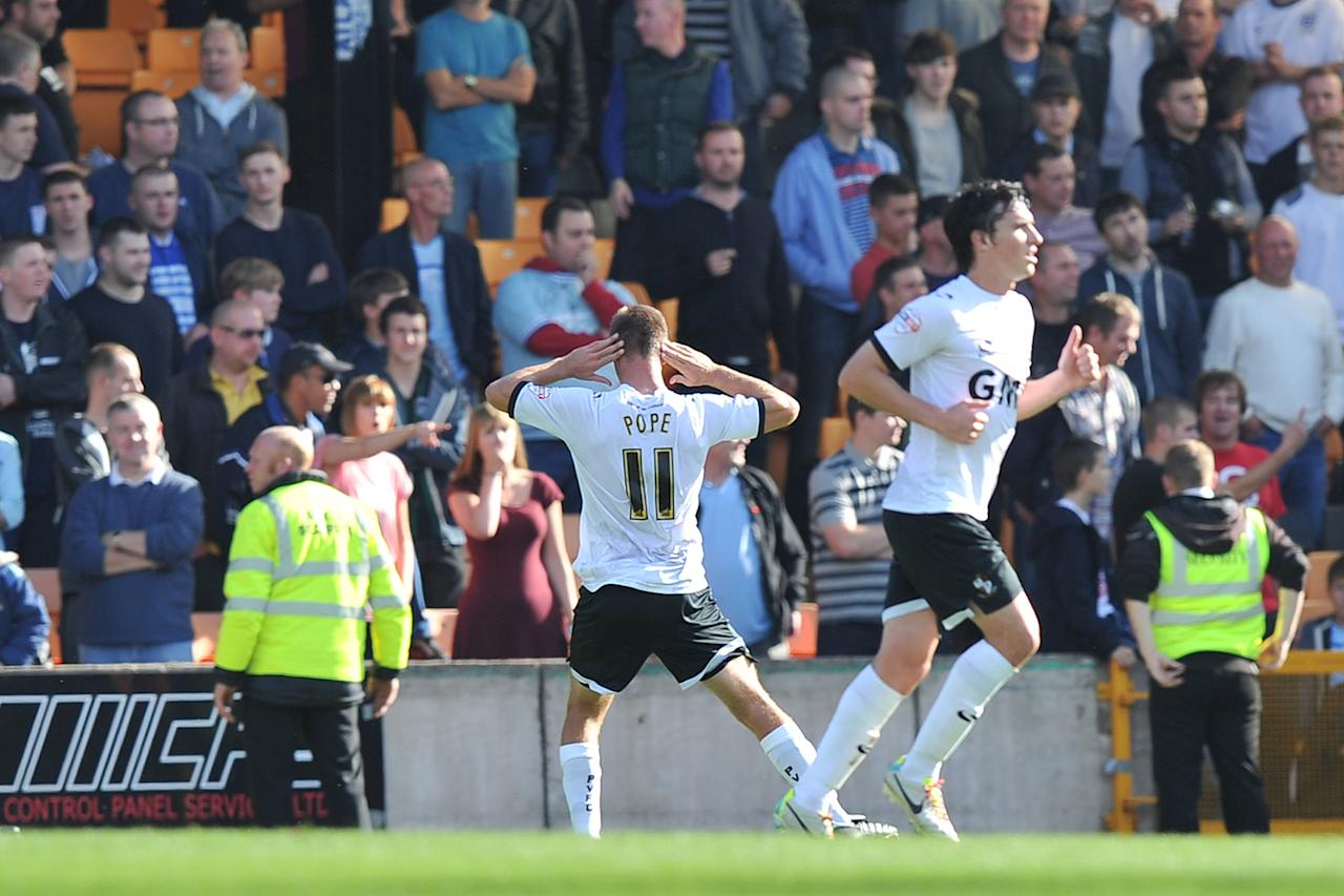 Port Vale's Tom Pope taunts the Coventry City fans after scoring his goal for Port Vale during the Sky Bet League One match at Vale Park, Stoke.