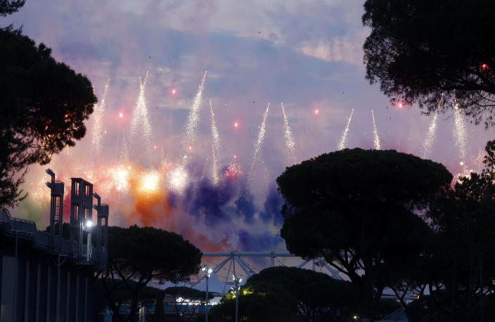 Fireworks illuminate the sky at the Olympic stadium during the inauguration ceremony held before the start of the Euro 2020 soccer championship group A match between Italy and Turkey, in Rome, Friday, June 11, 2021. (AP Photo/Riccardo De Luca)