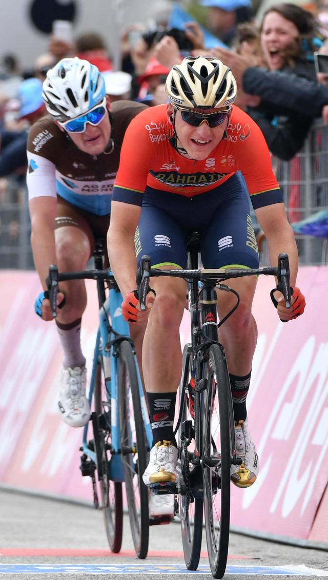 Slovenia's Matej Mohoric, right, sprints ahead of Germany Nico Denz on his way to win the 10th stage of the Giro d'Italia cycling race, from Penne to Gualdo Tadino d'Italia, Italy, Tuesday, May 15, 2018. Overall leader Simon Yates gained three bonus seconds in the 10th stage of the Giro d'Italia but it was a difficult day for his Mitchelton-Scott team as Esteban Chaves dropped out of contention. (Daniel Dal Zennaro/ANSA via AP)