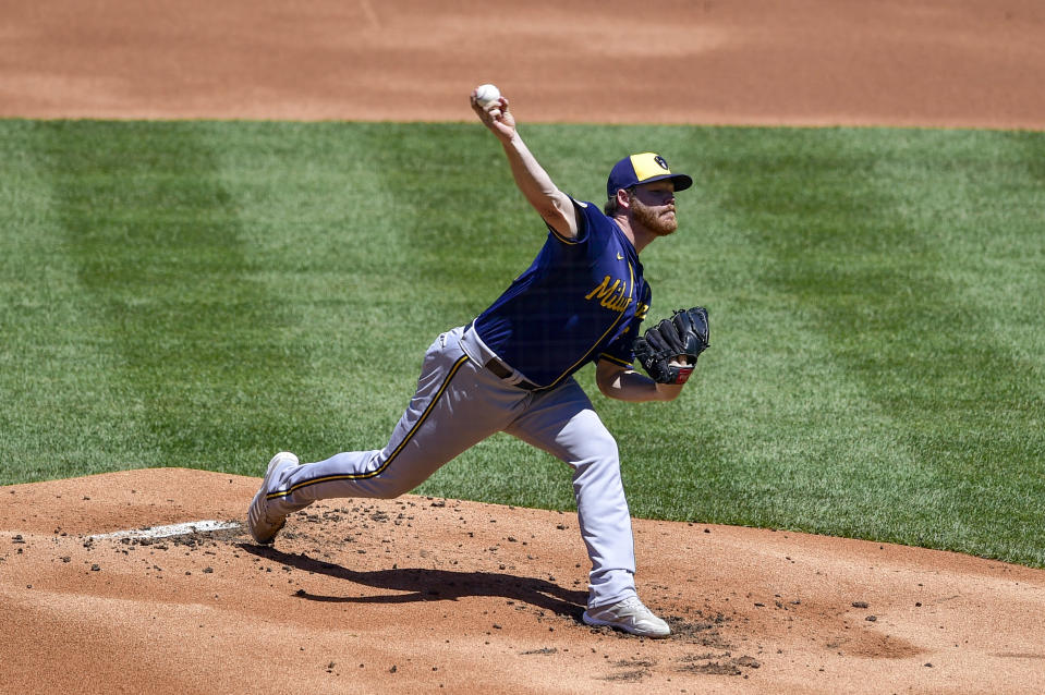 Milwaukee Brewers starting pitcher Brandon Woodruff throws the ball during the first inning of a baseball game against the Milwaukee Brewers, Thursday, May 6, 2021, in Philadelphia. (AP Photo/Derik Hamilton)