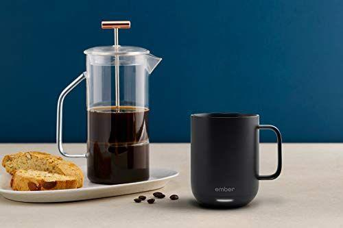 """<p><strong>Ember</strong></p><p>amazon.com</p><p><strong>$89.95</strong></p><p><a href=""""https://www.amazon.com/Ember-Black-Ceramic-Mug-Gen/dp/B07NQRM6ML?tag=syn-yahoo-20&ascsubtag=%5Bartid%7C10070.g.24378973%5Bsrc%7Cyahoo-us"""" rel=""""nofollow noopener"""" target=""""_blank"""" data-ylk=""""slk:Shop Now"""" class=""""link rapid-noclick-resp"""">Shop Now</a></p><p>It's pricey, but if your boss loves sipping tea or coffee while they work, this app-controlled mug keeps their cuppa somewhere between 120°F and 145°F at all times.</p>"""