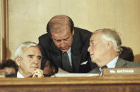 FILE - In this Aug. 14, 1986, file photo Senate Judiciary Committee members from left, Sen. Paul Laxalt, R-Nev., Sen. Joseph Biden, D-Del., and Sen. Charles McCurdy Mathias Jr., R-Md. confer prior to voting 13 to 5 in Washington on Capitol Hill in favor of President Ronald Reagan's nomination of William Rehnquist to be chief justice. (AP Photo/Lana Harris, File)