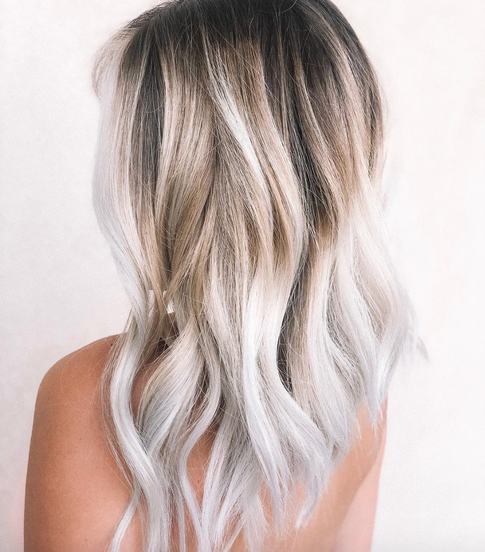 """A riff on the <a href=""""https://www.glamour.com/gallery/the-10-best-hair-colors-for-fall-2016?mbid=synd_yahoo_rss#4"""" rel=""""nofollow noopener"""" target=""""_blank"""" data-ylk=""""slk:bronde"""" class=""""link rapid-noclick-resp"""">bronde</a> trend, toasted coconut is even more low-maintenance. Unlike for your usual bronde, Atlanta hairstylist <a href=""""https://www.instagram.com/kayluhskolors/"""" rel=""""nofollow noopener"""" target=""""_blank"""" data-ylk=""""slk:Kayluh Stewart"""" class=""""link rapid-noclick-resp"""">Kayluh Stewart</a> uses an icy toner to make the blond look almost silvery, while the roots are still a deep, dark brown—hence the """"toasted"""" part."""