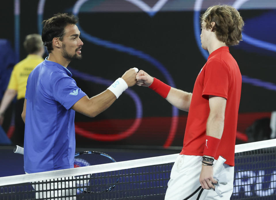 Russia's Andrey Rublev, right, is congratulated by Italy's Fabio Fognini after winning their match in the ATP Cup final in Melbourne, Australia, Sunday, Feb. 7, 2021.(AP Photo/Hamish Blair)
