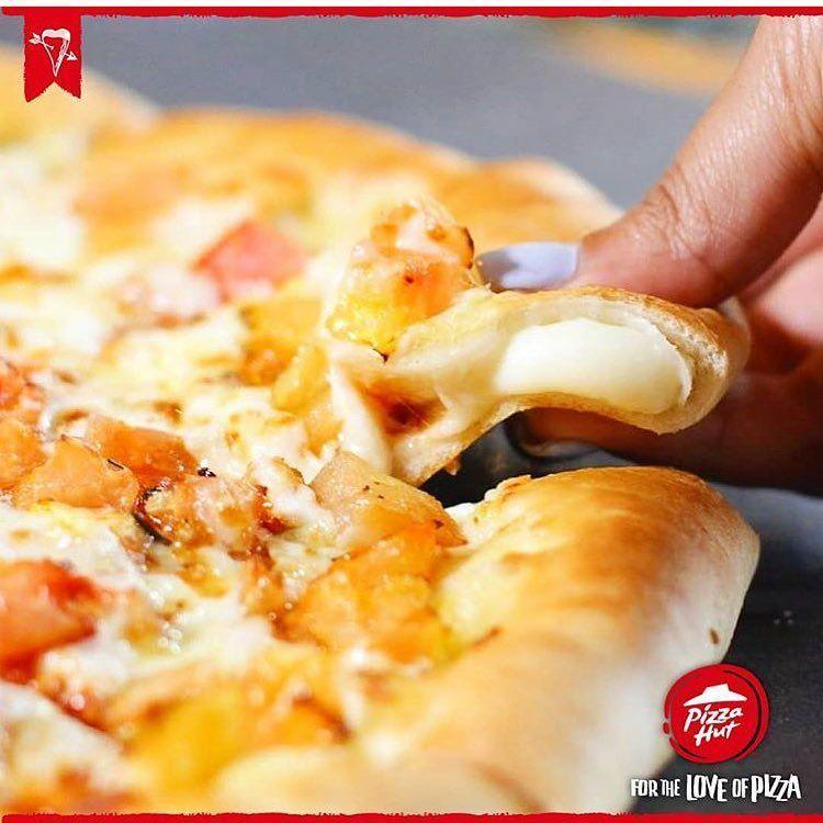 """<p><em>Of course</em> the stuffed crust pizza is Pizza Hut's most popular item. It's pizza with <em>cheese in the crust</em>. That's double the helping of gooey cheese, in case you're keeping count. Pizza Hut gifted the world with this mad genius spin on pizza <a href=""""https://www.businessinsider.com/stuffed-crust-pizza-origins-2013-2"""" rel=""""nofollow noopener"""" target=""""_blank"""" data-ylk=""""slk:in 1995"""" class=""""link rapid-noclick-resp"""">in 1995</a>. Ever since, the only thing up for debate about it is how to eat it: crust first or last. </p>"""