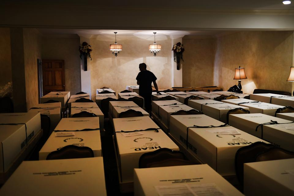 Omar Rodriguez organizes bodies in the Gerard Neufeld funeral home in Queens on April 22, 2020 in New York City. (Spencer Platt/Getty Images)