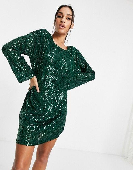 "<p><strong>ASOS Design</strong></p><p>us.asos.com</p><p><strong>$56.00</strong></p><p><a href=""https://go.redirectingat.com?id=74968X1596630&url=https%3A%2F%2Fwww.asos.com%2Fus%2Fasos-design%2Fasos-design-padded-shoulder-long-sleeve-v-back-sequin-mini-dress-in-forest-green%2Fprd%2F21524566&sref=https%3A%2F%2Fwww.oprahmag.com%2Fstyle%2Fg34688882%2Fnew-years-eve-outfit-ideas%2F"" rel=""nofollow noopener"" target=""_blank"" data-ylk=""slk:SHOP NOW"" class=""link rapid-noclick-resp"">SHOP NOW</a></p><p>Make an entrance (and an exit) in this low-back sequin dress. It doesn't need much so just accessorize with simple strappy sandals and some stacked earrings. </p>"