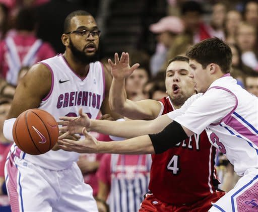 The ball gets away from Creighton's Doug McDermott, right, with Bradley's Jake Eastman (4) defending, and Creighton's Gregory Echenique, left, looking on, in the first half of an NCAA college basketball game in Omaha, Neb., Saturday, Feb. 2, 2013. (AP Photo/Nati Harnik)