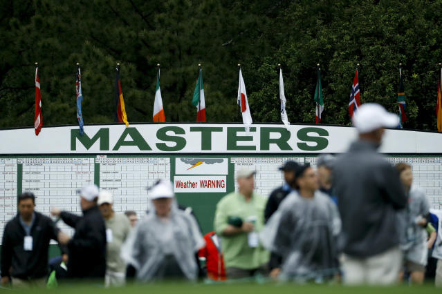 FILE - In this April 9, 2019, file photo, fans arrive for a practice round that's under a weather warning at the Masters golf tournament in Augusta, Ga. Augusta National decided Friday, March 13, 2020, to postpone the Masters because of the spread of the coronavirus. Club chairman Fred Ridley says he hopes postponing the event puts Augusta National in the best position to host the Masters and its other two events at some later date. Ridley did not say when it would be held. (AP Photo/Matt Slocum, FIle)