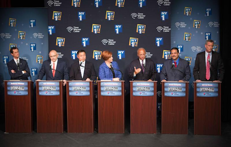 The Democratic candidates for Mayor of New York City, from left, Anthony Weiner, Sal Albanese, John Liu, Christine Quinn, William Thompson Jr., Erick Salgado and Bill de Blasio, face off for their first debate at the Town Hall Wednesday, Aug. 21, 2013 in New York. (AP Photo/New York Times, Ruth Fremson, Pool)