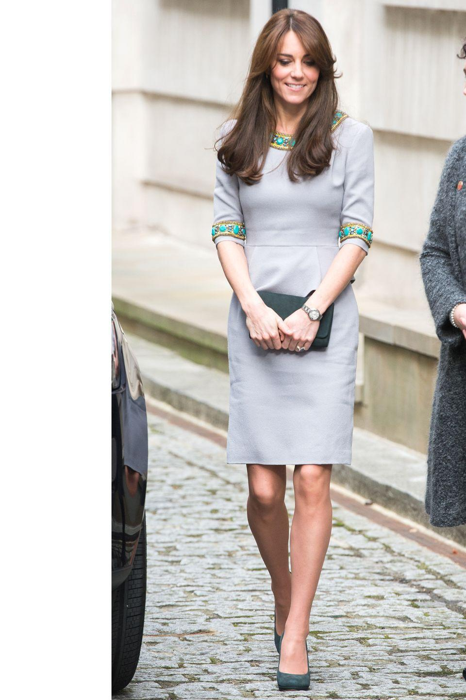 """<p>The Duchess steps out for the """"My Head Is Too Full"""" in a pastel dress by Matthew Williamson, adorned with turquoise trim and teal accessories. </p>"""