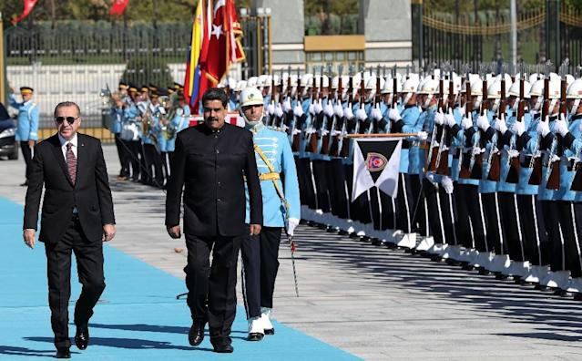 Venezuela's leader Nicolas Maduro (R) and Turkish President Recep Tayyip Erdogan (L) walk past honor guard during an official welcome ceremony in Ankara on the first state visit to Turkey by a Venezuelan president. (AFP Photo/ADEM ALTAN)