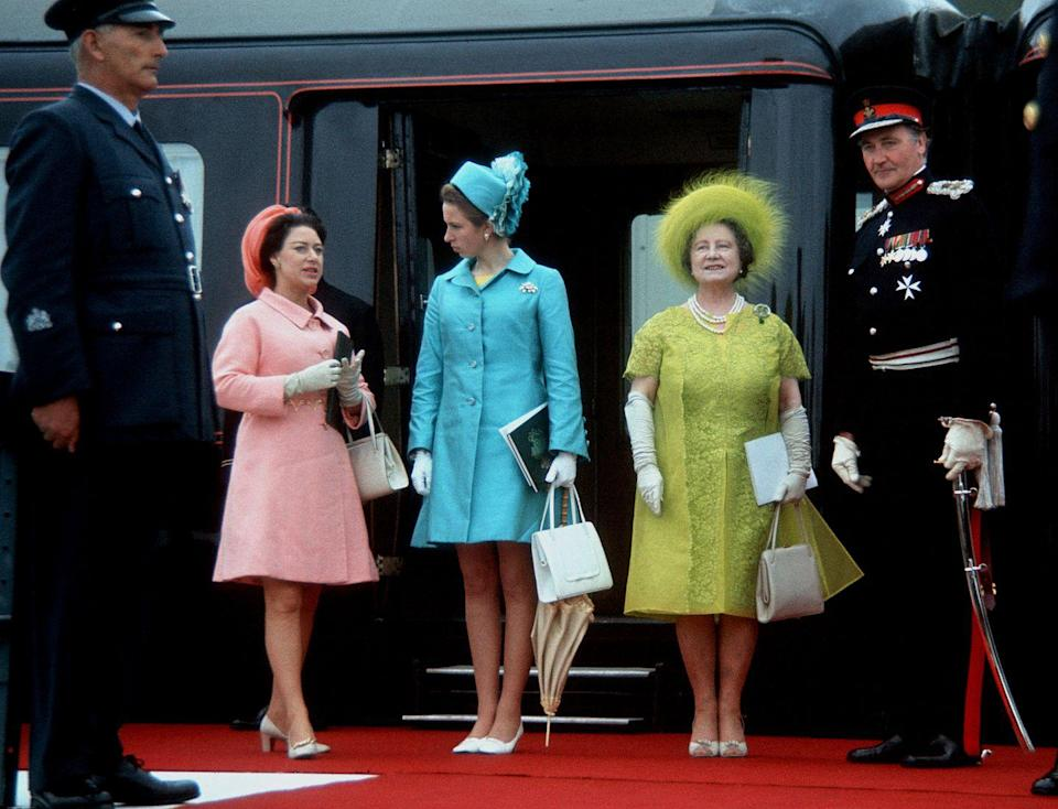 <p>A colorful display. Princess Margaret, in pink, attended Prince Charles's investiture as the Prince of Wales. </p>