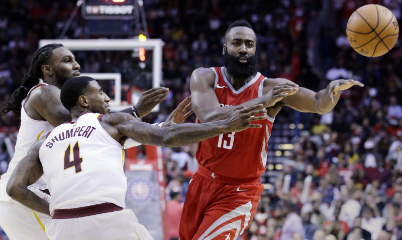 Houston Rockets guard James Harden (13) passes under pressure from Cleveland Cavaliers forward Jae Crowder (99) and guard Iman Shumpert (4) during the second half of an NBA basketball game Thursday, Nov. 9, 2017, in Houston. (AP Photo/Michael Wyke)