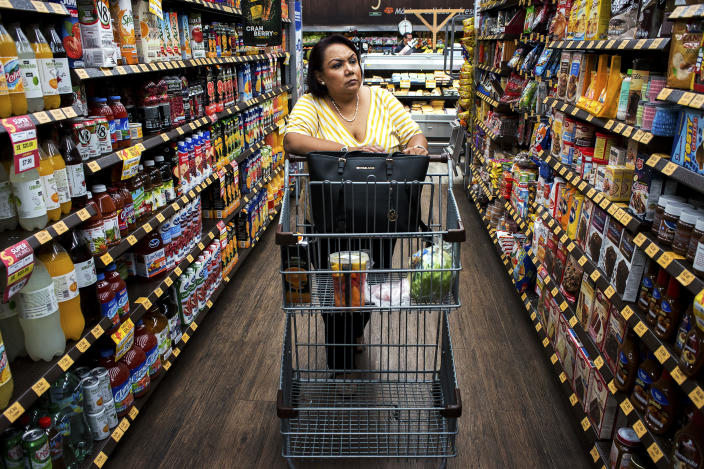 """<p>Giosefina Gaytan Caballero, 51, shops in a supermarket. Caballero suffers from rheumatoid arthritis whose symptoms are aggravated by his condition of obesity. """"Some would say Mexico's traditional foods are the cause, but that's not the case,"""" said Fabio Da Silva Gomes, regional advisor on nutrition at the Pan American Health Organization (PAHO), a part of the World Health Organization. """"If you look at the evidence, what you really see increasing is not an epidemic of traditional soups or beans. No. What is happening is the increase of ultra-processed products and sugary drinks."""" (Photograph by Silvia Landi) </p>"""