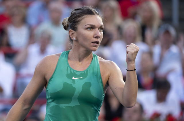 Simona Halep, of Romania, celebrates a point over Caroline Garcia, of France, during women's quarterfinal play at the Rogers Cup tennis tournament in Montreal on Friday, Aug. 10, 2018. (Paul Chiasson/The Canadian Press via AP)