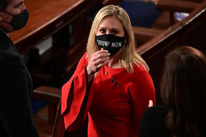 """U.S. Rep. Marjorie Taylor Greene (R-GA) wears a """"Trump Won"""" face mask as she arrives on the floor of the House to take the oath office on the year's opening session on January 3, 2021 in Washington, DC. (Photo by Erin Scott-Pool/Getty Images)"""
