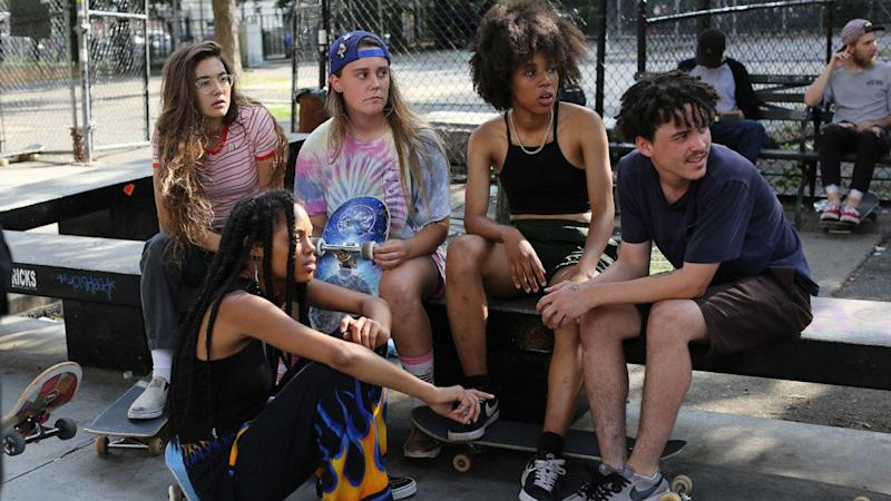 """The girls in """"Skate Kitchen"""" glide through the New York streets, skateboards propelling their adolescent odyssey. This motley clique -- made up of different races, sexualities, temperaments, insecurities --&nbsp;have a preternatural connection, catching one another when they fall and absorbing each other's lives the way only teenagers can.&nbsp;<br /><br />Director Crystal Moselle, who made the 2015 documentary """"The Wolfpack,"""" said she met the&nbsp;group on the subway. Incorporating&nbsp;their real personas, she scripted a gauzy narrative about a shy newcomer (Rachelle Vinberg) who finds refuge with this very different sort of wolf pack. Invoking shades of """"Kids"""" and """"American Honey,"""" """"Skate Kitchen"""" is&nbsp;a v&eacute;rit&eacute; ollie full of life at its most bittersweet and its most vivacious. The plot is loose in the best sense, and the results make for a serene jaunt through the fleeting, beautiful&nbsp;days that will&nbsp;soon make these girls -- and the boys who surround them, including one played by Jaden Smith -- nostalgic for their youth. -- <i>MJ</i>"""